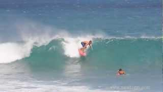 Surfer Surfing a Quad Fin Retro Fish Surfboard at Rocky Point in Hawaii. Video by Paul Topp